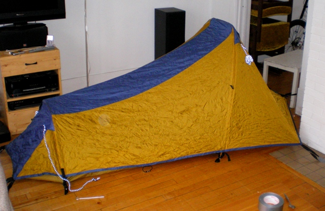 Side view of the tent in the living room. Staked out with duct-tape