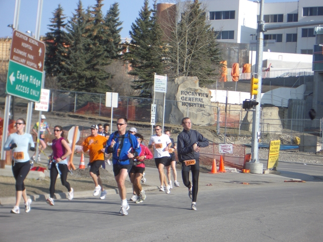 Throwing toque and mitts off into the ditch. Calgary Police Half Marathon: April 27, 2008.